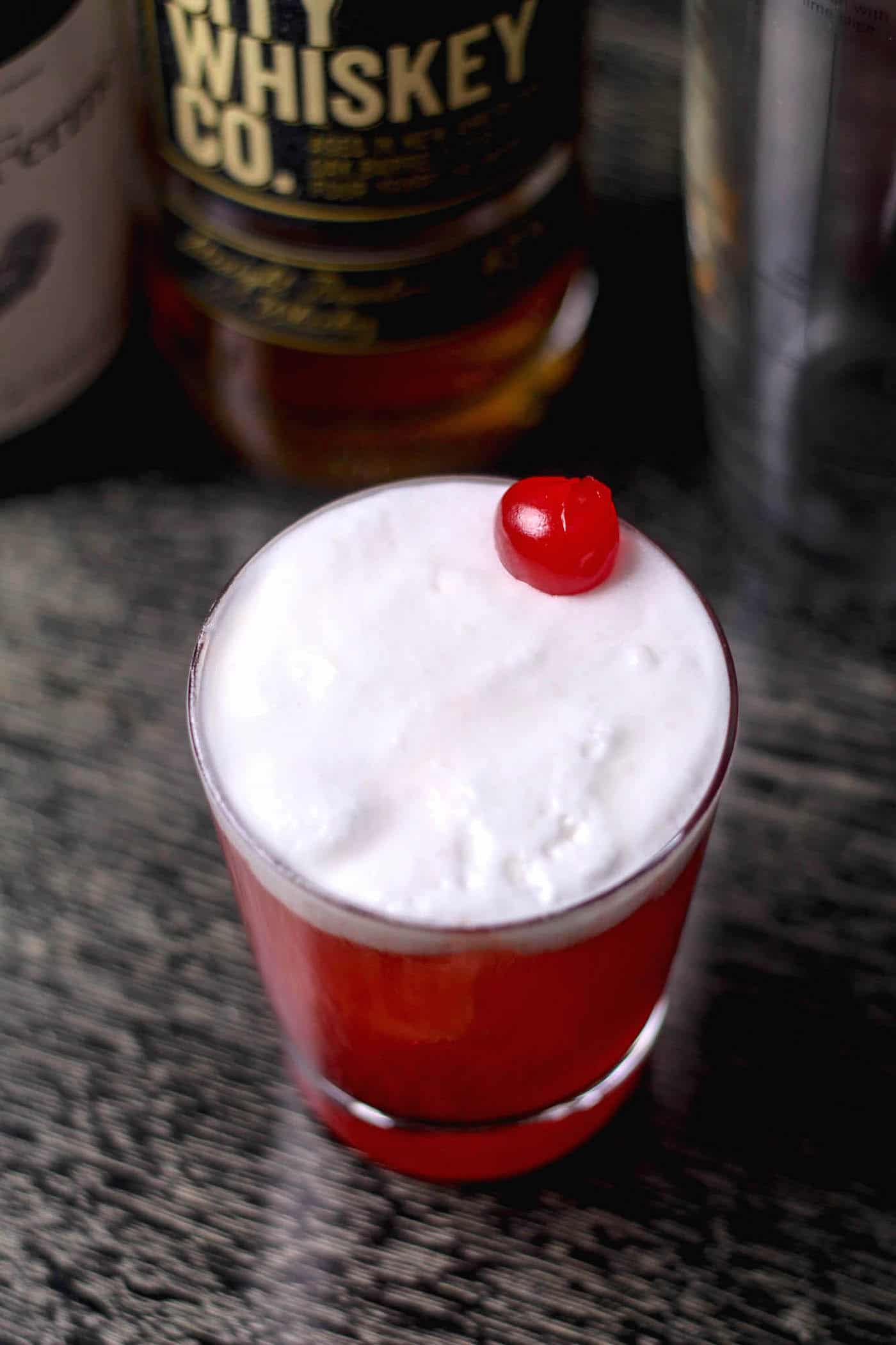 cherry juice cocktail with egg white foam