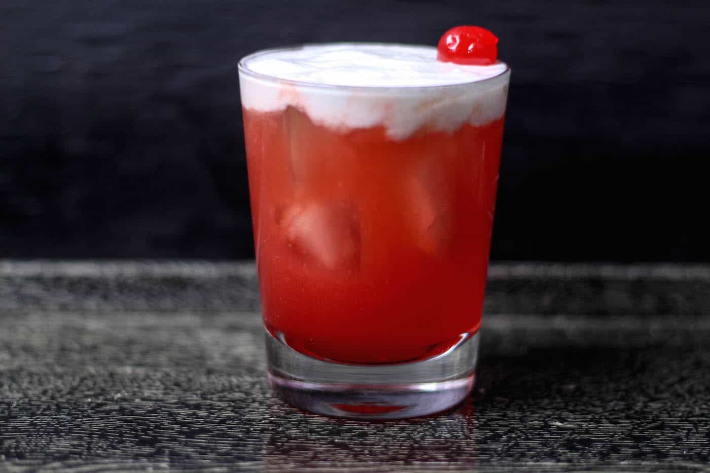 This cherry whiskey sour recipe uses maraschino cherries and their juice as the sweetener. It's easy to make and oh, so smooth and tart!