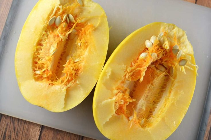 Spaghetti squash cut lengthwise, showing the insides