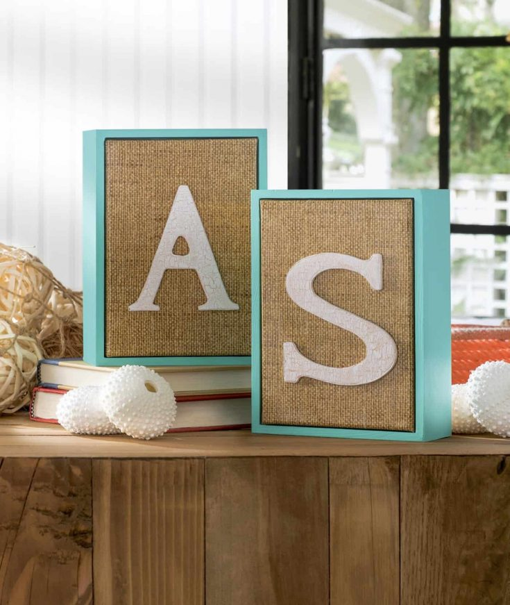 Create the prettiest personalized nautical wall art using faux burlap - made with a cool Duck Tape print! This project couldn't be any easier!