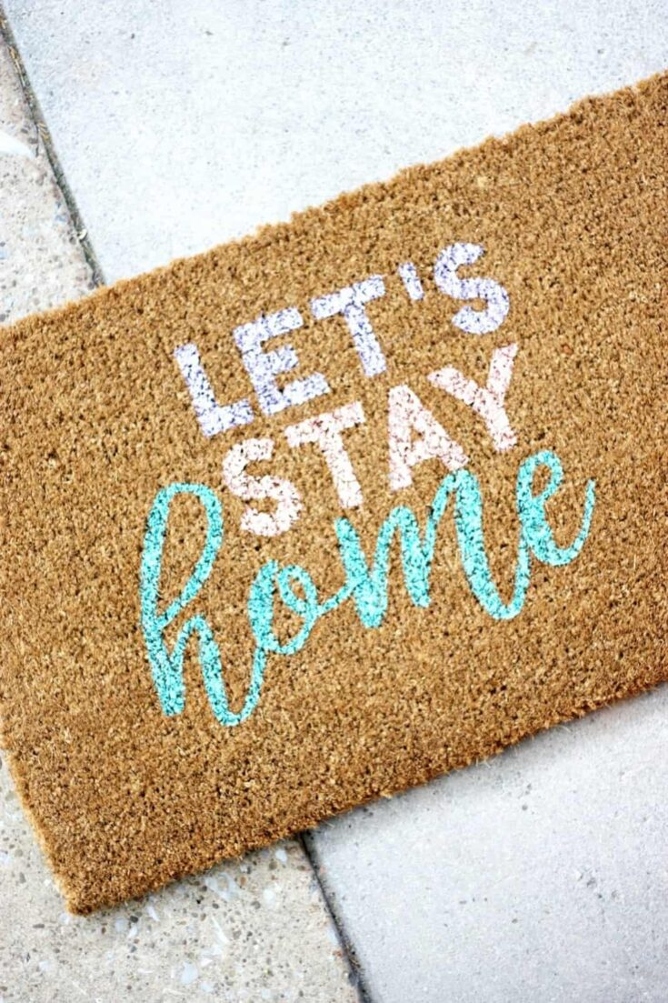 Add your favorite saying to the front of your home with this colorful and cute personalized door mat project! It's way easier to make than you might think.