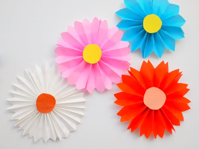 These accordion paper flowers are so easy to make that even a child can do it - pick bright, bold origami patterns to make them really stand out!