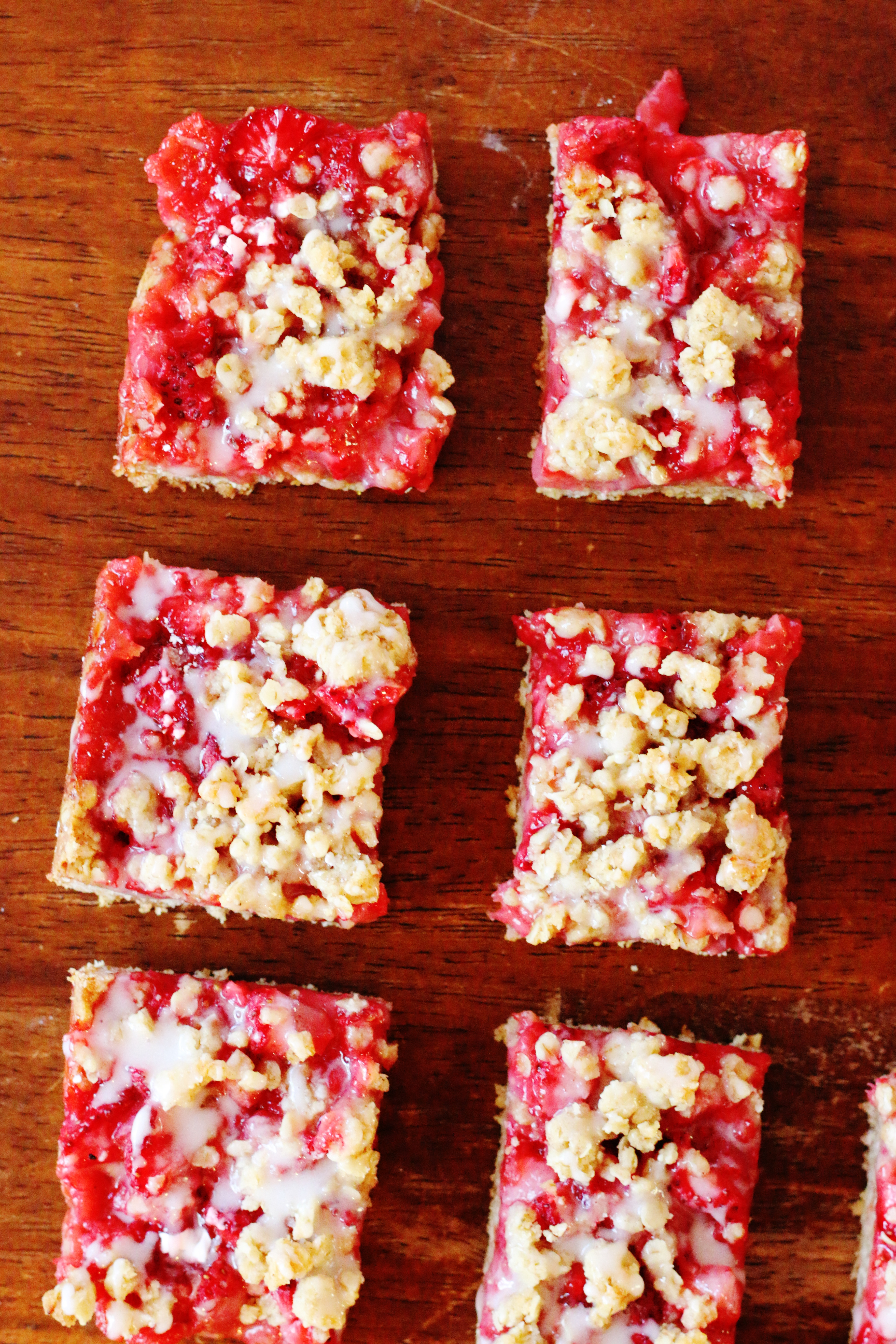 These oatmeal bars feature strawberries spread over a buttery, streusel-like crust. The vanilla glaze makes them even more delicious! You'll love this amazingly easy recipe.