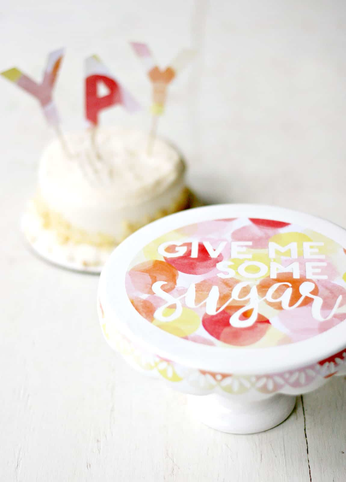 This simple DIY cake stand is easy to embellish with your favorite scrapbook paper and Mod Podge