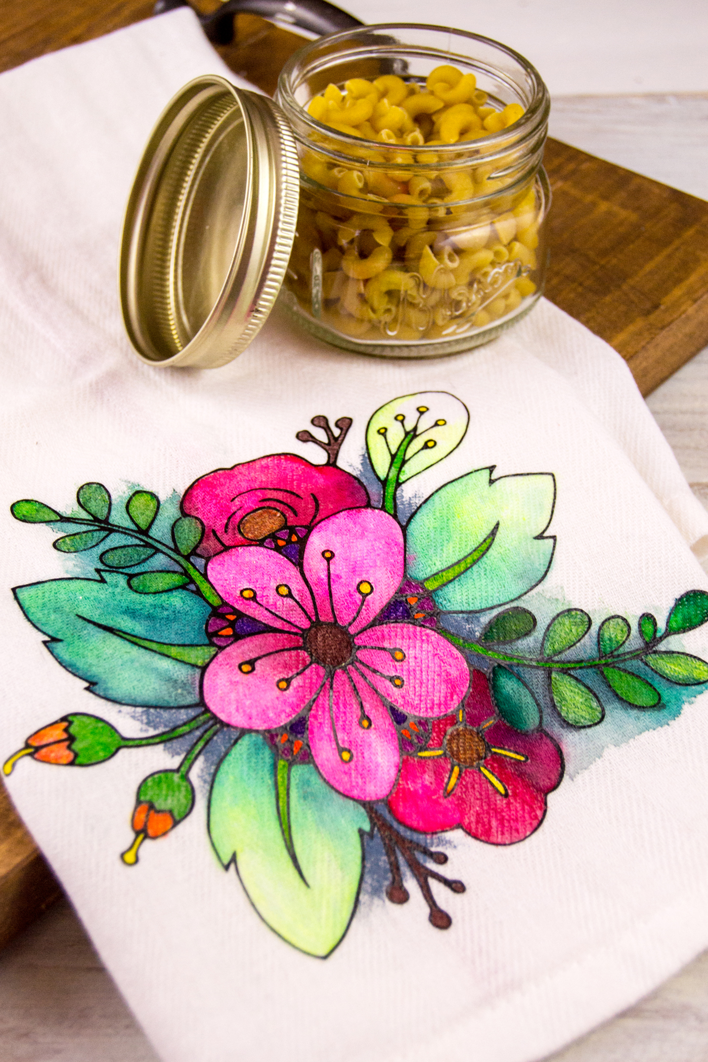 Adult coloring isn't just for the pages of a coloring book - use fabric markers on this DIY tea towel to make a unique gift personalized with color!