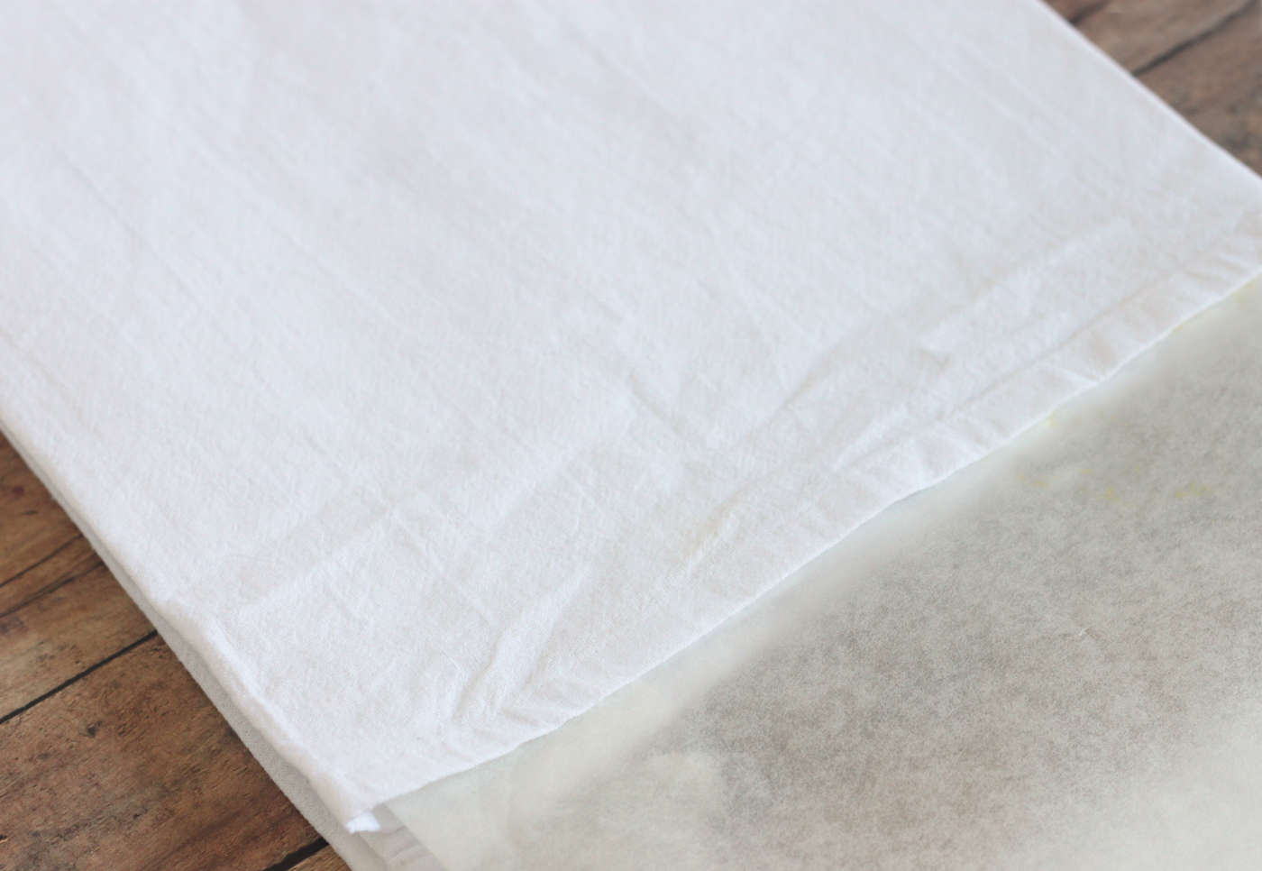 place wax paper in between layers of a tea towel