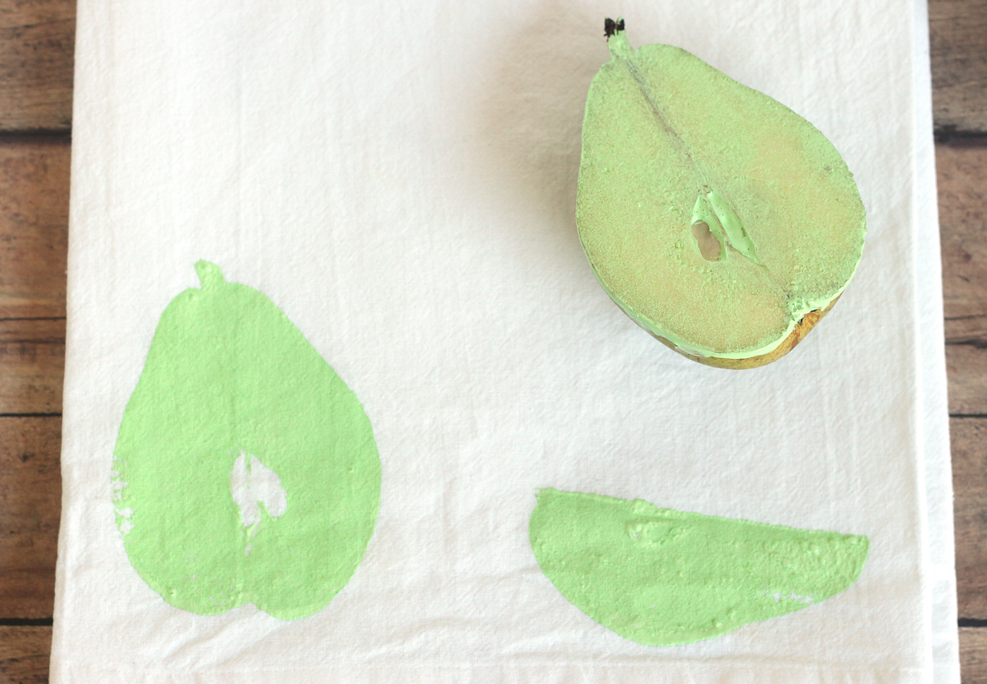 Pear with paint stamped onto fabric