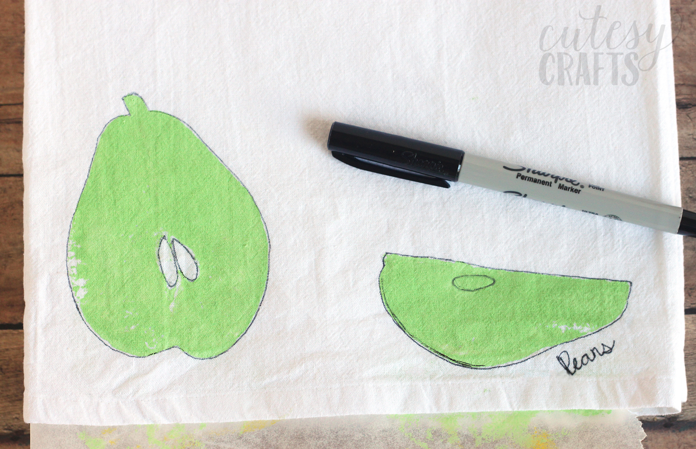 Outline a fruit stamp with a permanent marker