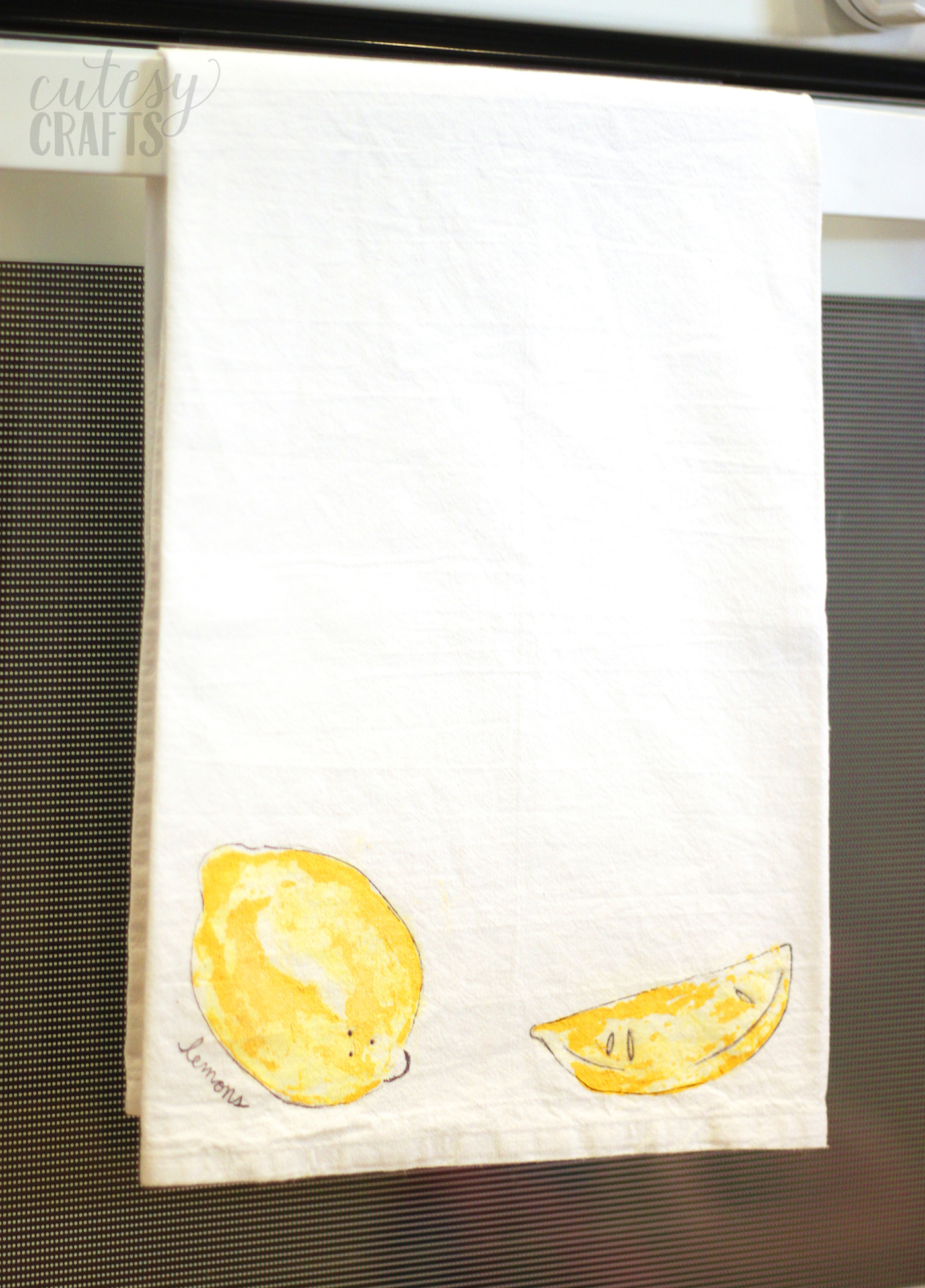 Fruit stamping on a tea towel with lemons