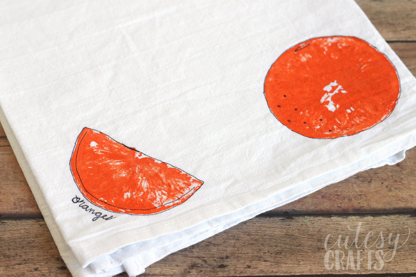 Fruit stamping on a tea towel using an orange