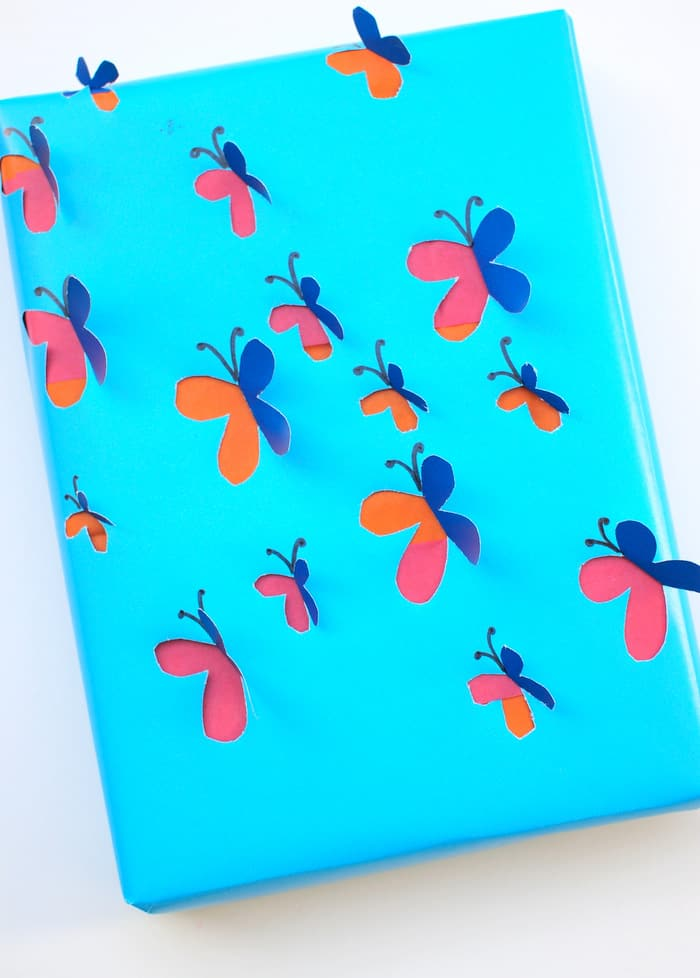 This DIY wrapping paper is easy to make - and the butterflies look like they are coming off the package! Impress any gift recipient with your creativity.