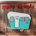 """Share your love of travel with this unique """"ready to roll"""" camper pallet art! It didn't cost us much to make - we got the pallets for free. So fun!"""