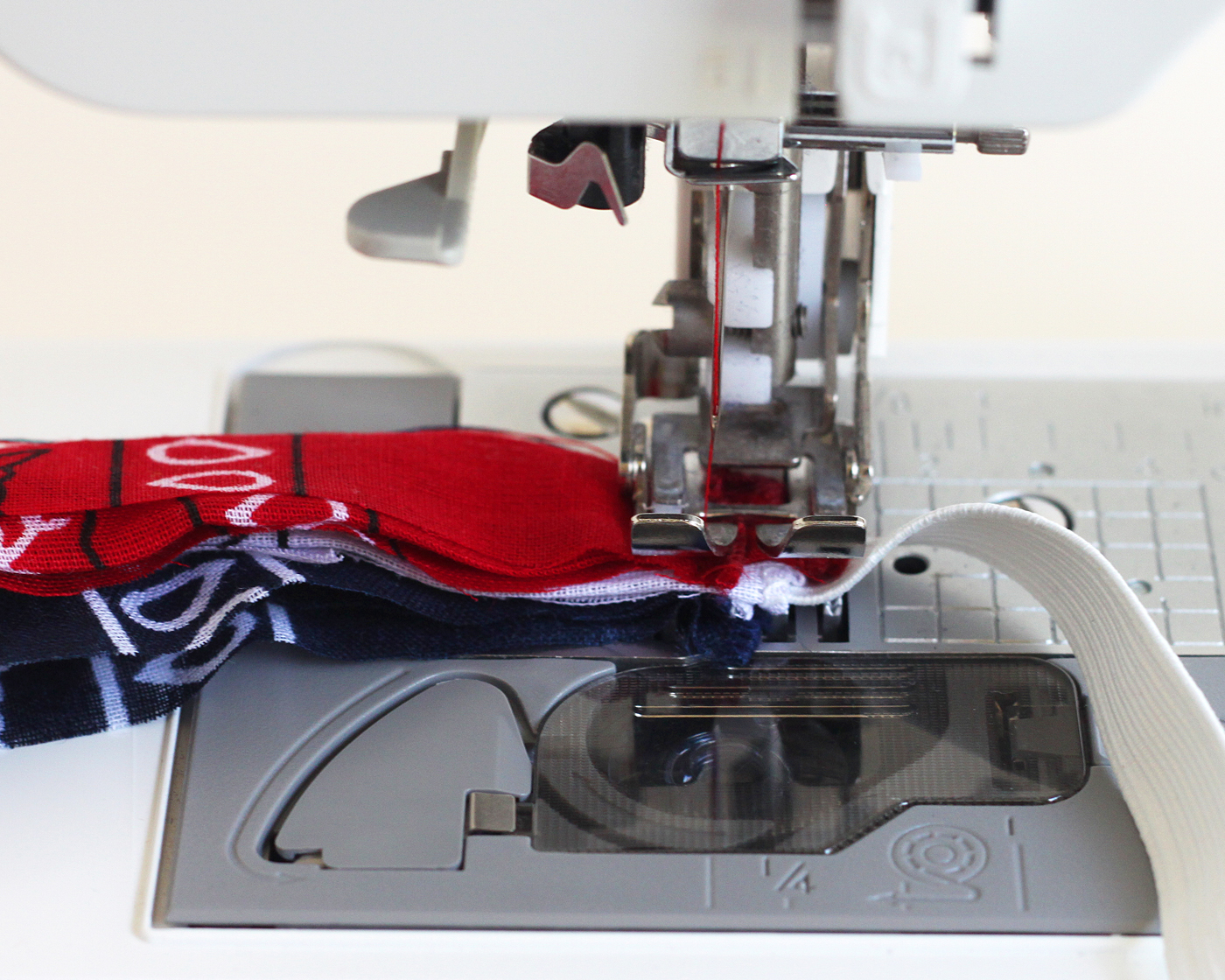 Sewing elastic into bandanas with a sewing machine