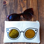 Learn how to make a unique DIY sunglasses case using heat transfer vinyl and a die cutter. This trendy project includes a free template!