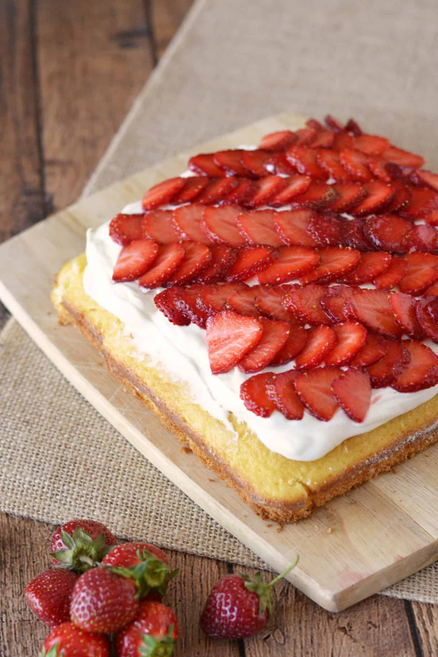 This strawberry cake recipe is a showstopper! It's moist and delicious - and not too sweet. Make this pretty, tasty dessert quickly and easily.