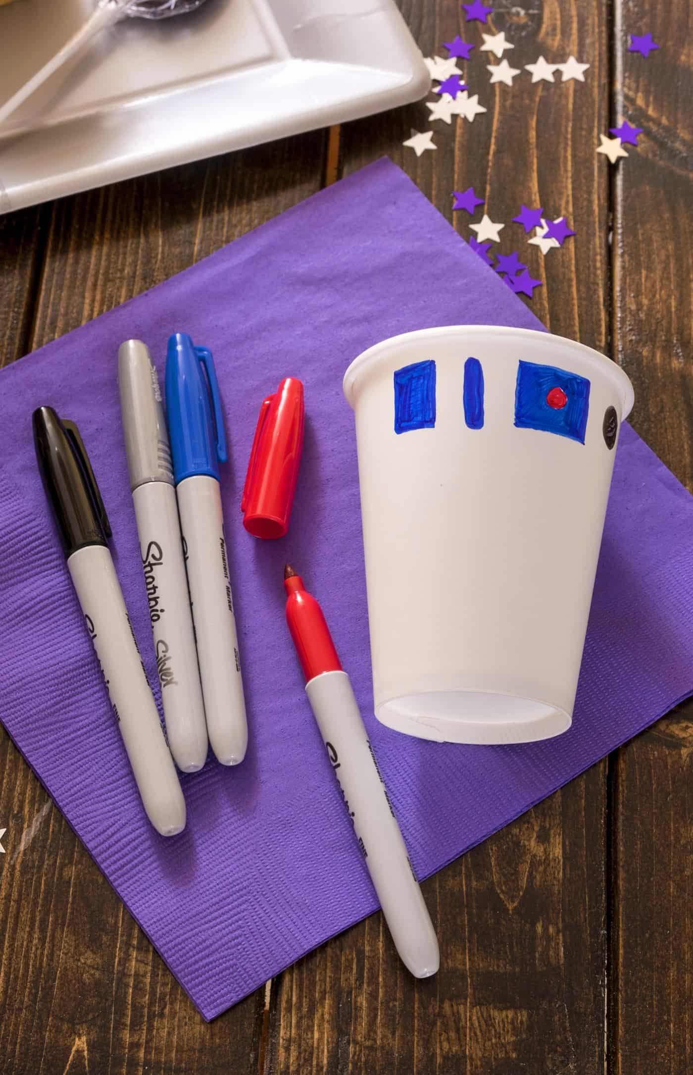 Learn how to have a Star Wars birthday party without blowing your kid's college fund! Here are my favorite tips and ideas including an R2-D2 DIY cup.