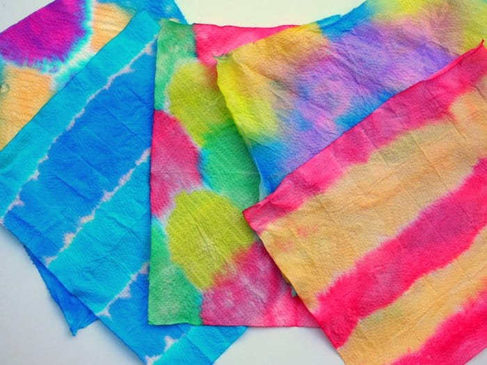 Use liquid watercolors or food coloring to make this unique dip dyed kids wall art project. Kids will have so much fun and the results are stunning!