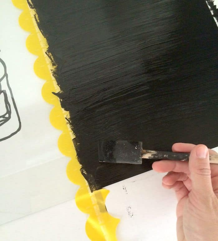 Painting a second layer of chalkboard paint on the glass