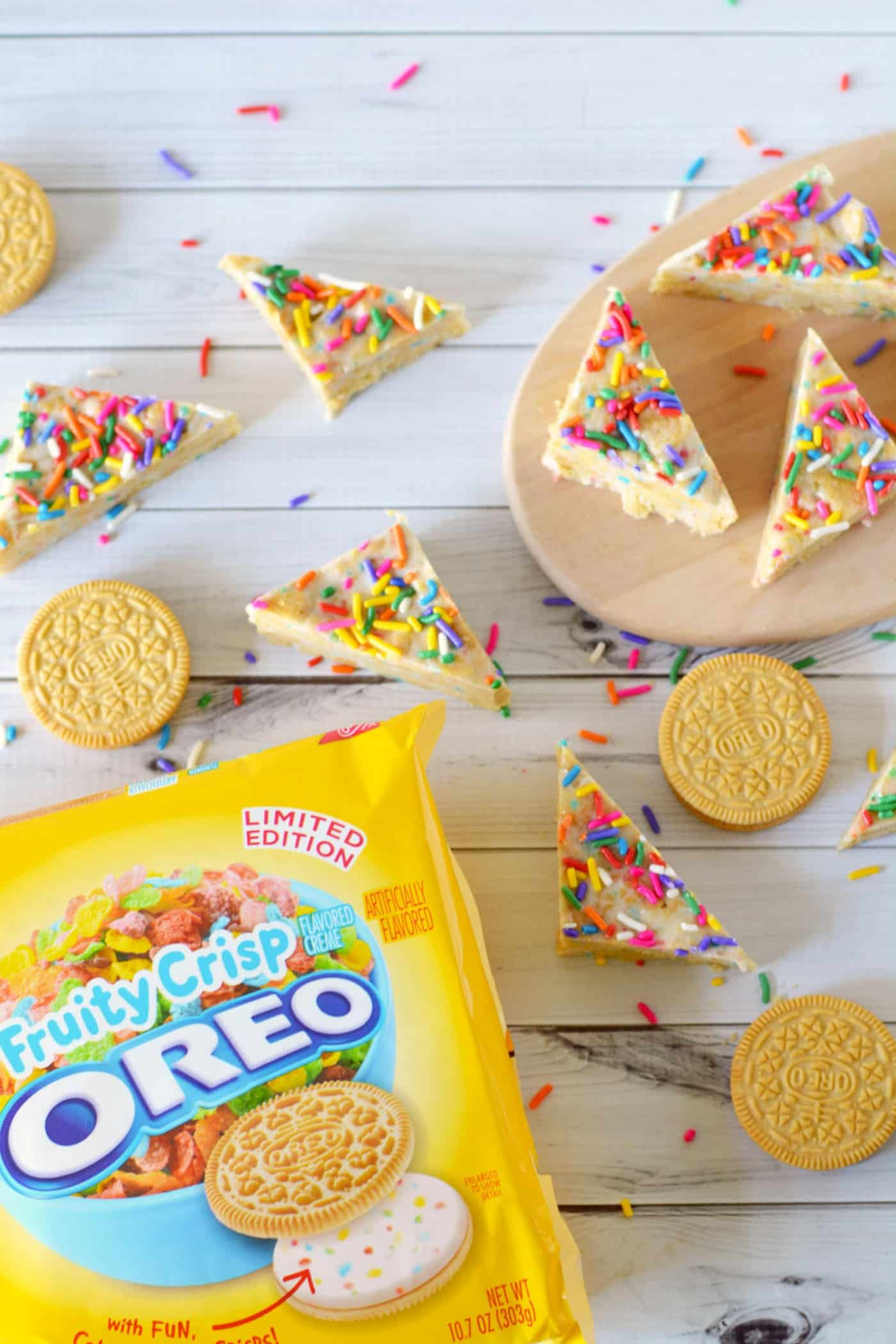 This Oreo dessert features delicious cereal bits that taste just like Fruity Pebbles! Easy to make because it's no bake - your kids will love these.