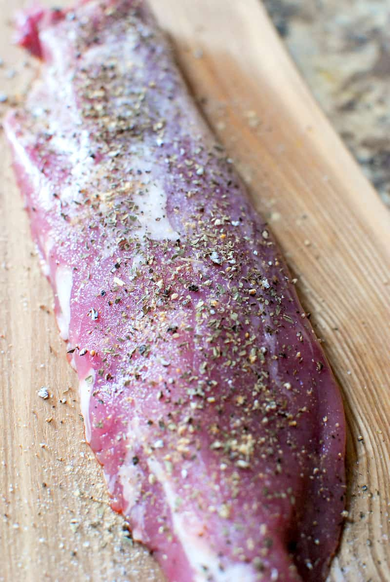 Raw pork tenderloin (fillet) with spices