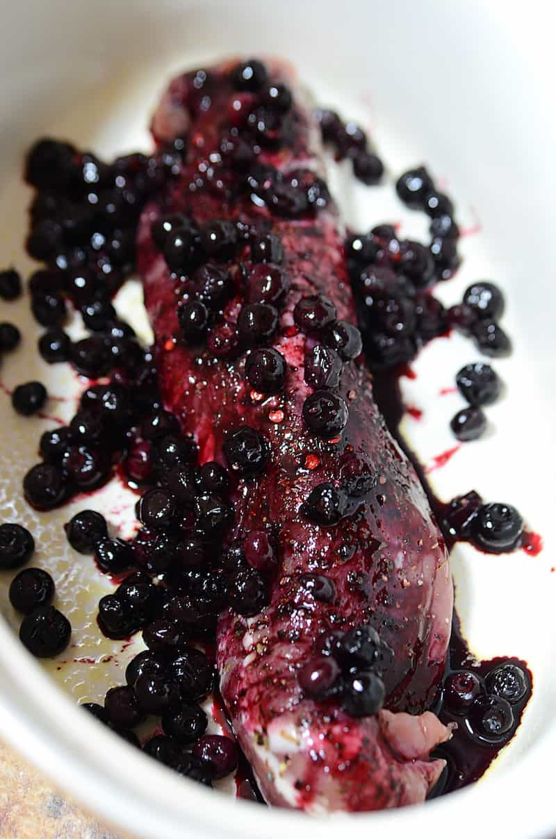 Place blueberry sauce over the top of the raw pork loin