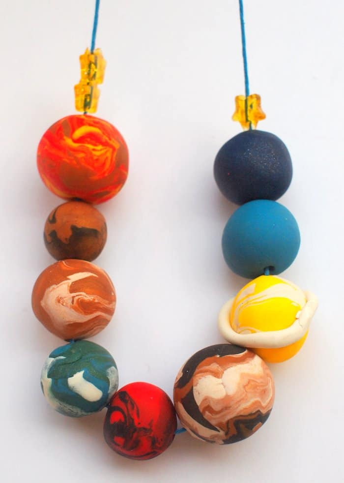 Are you looking for a kids jewelry project that's out-of-this-world fun? This strand of planets is made with clay - it's really easy to do!