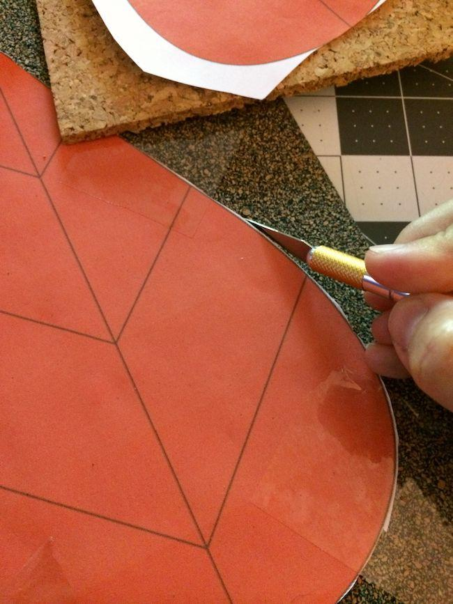 Cutting out a template on cork with a craft knife