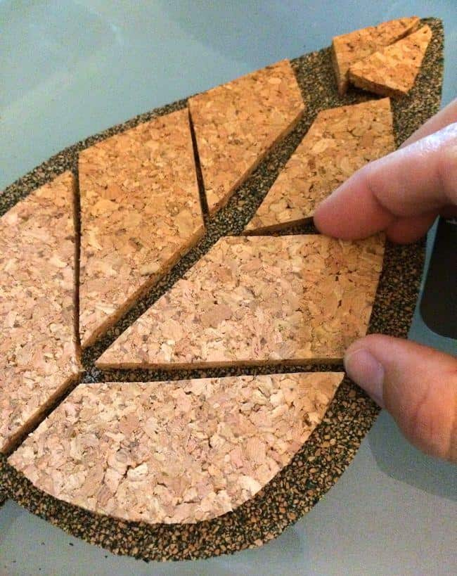 Assembling cork pieces to make trivets