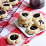 These are the most delectable thumbprint cookies filled with a perfect pool of decadent blueberry lemon homemade jam. They are so moist and light!