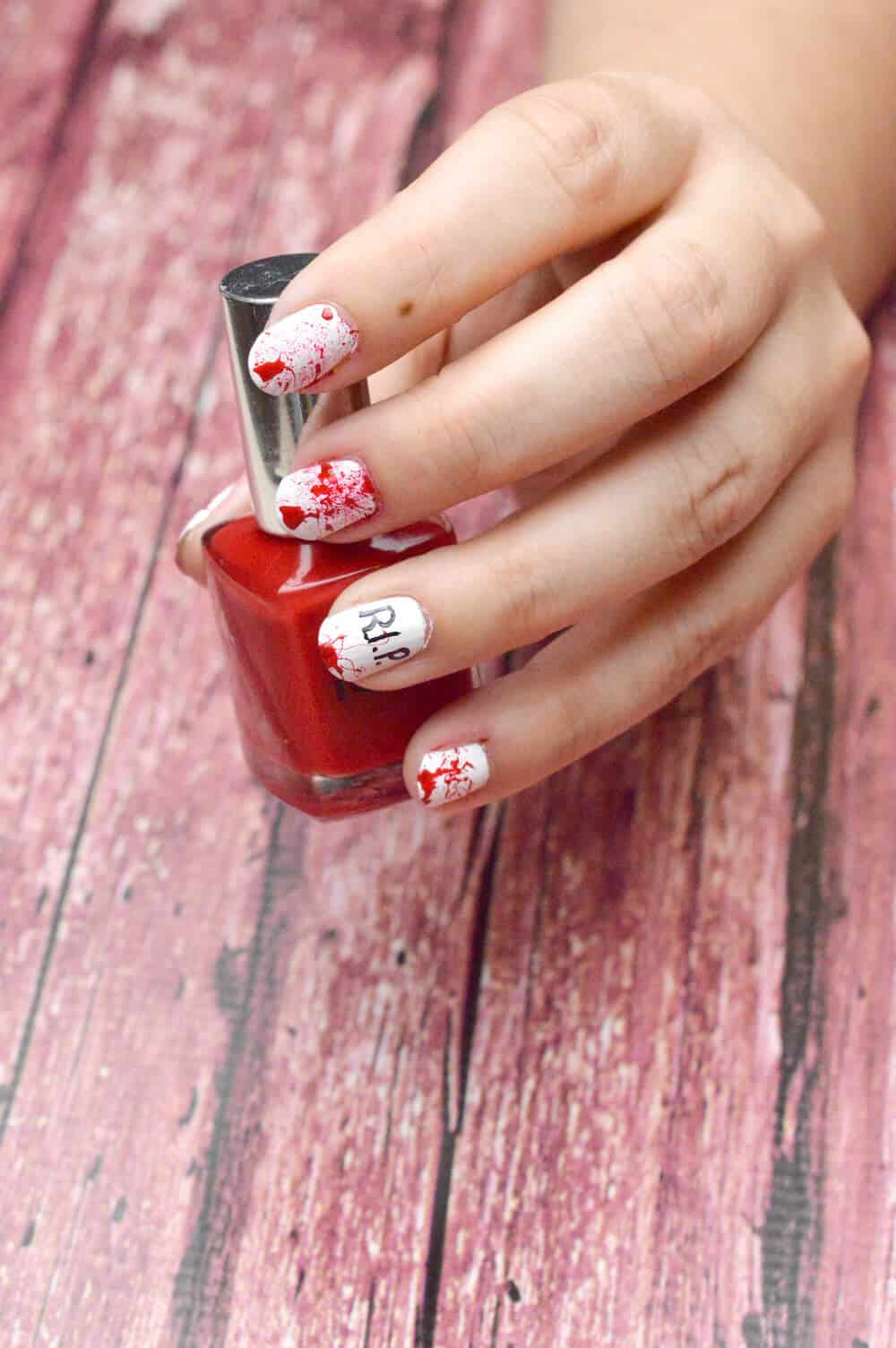 """Are you looking for unique Halloween nail designs for the holiday? Try these """"Bloody R.I.P."""" and """"Sparkle Cat"""" options. They are so easy to do!"""