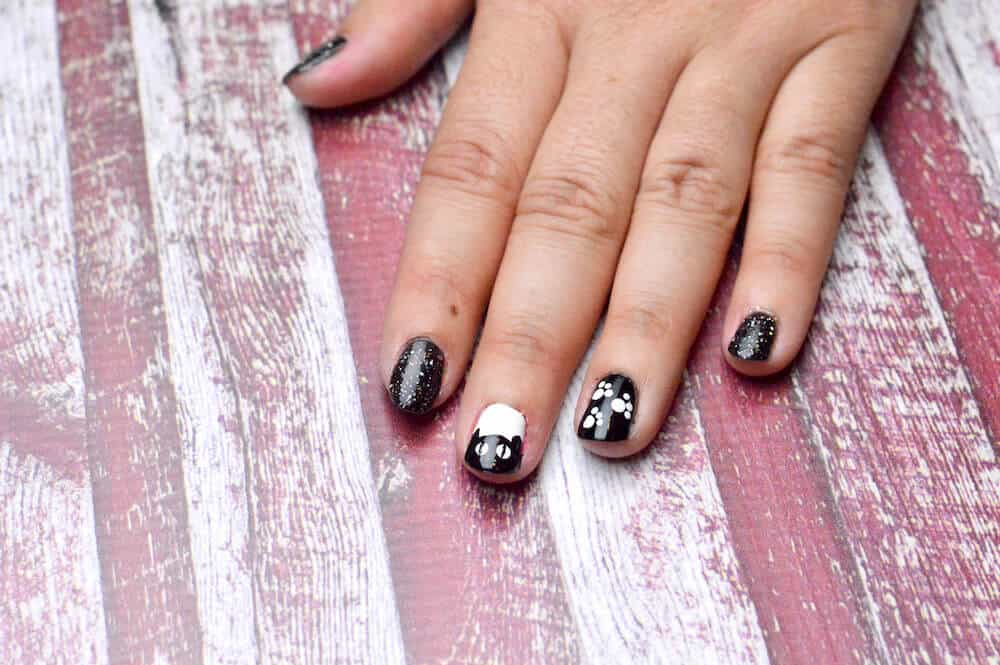 "Are you looking for unique Halloween nail designs for the holiday? Try these ""Bloody R.I.P."" and ""Sparkle Cat"" options. They are so easy to do!"