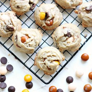 These delicious dark chocolate chip cookies include white chocolate butterscotch M&M's and yummy pecans. The perfect way to jazz up a plain cookie recipe!