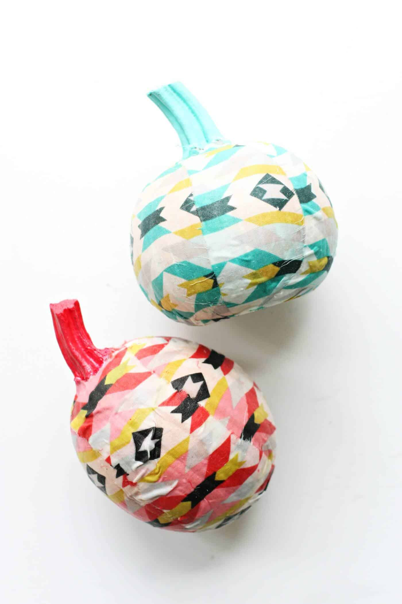 Use a cool and modern fabric to make these unique fabric covered pumpkins! You'll love this easy, no carve idea made with Mod Podge.