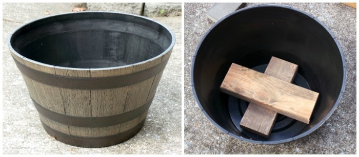 Planter with two pieces of wood in the bottom