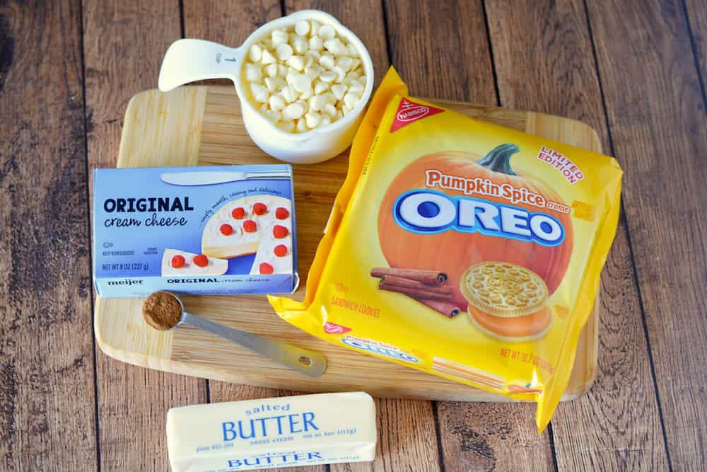 These delicious cream cheese bars are made with Pumpkin Spice Oreos! You are going to LOVE this no bake dessert - make it in minutes. Perfect for parties!