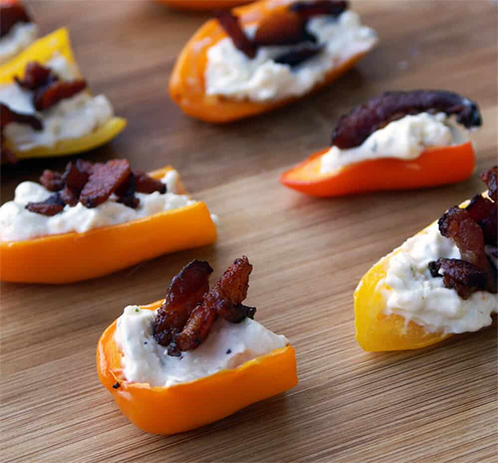 Do you love Trader Joe's?! This delicious mini stuffed peppers recipe uses my favorites from there! It's the perfect budget friendly appetizer idea.