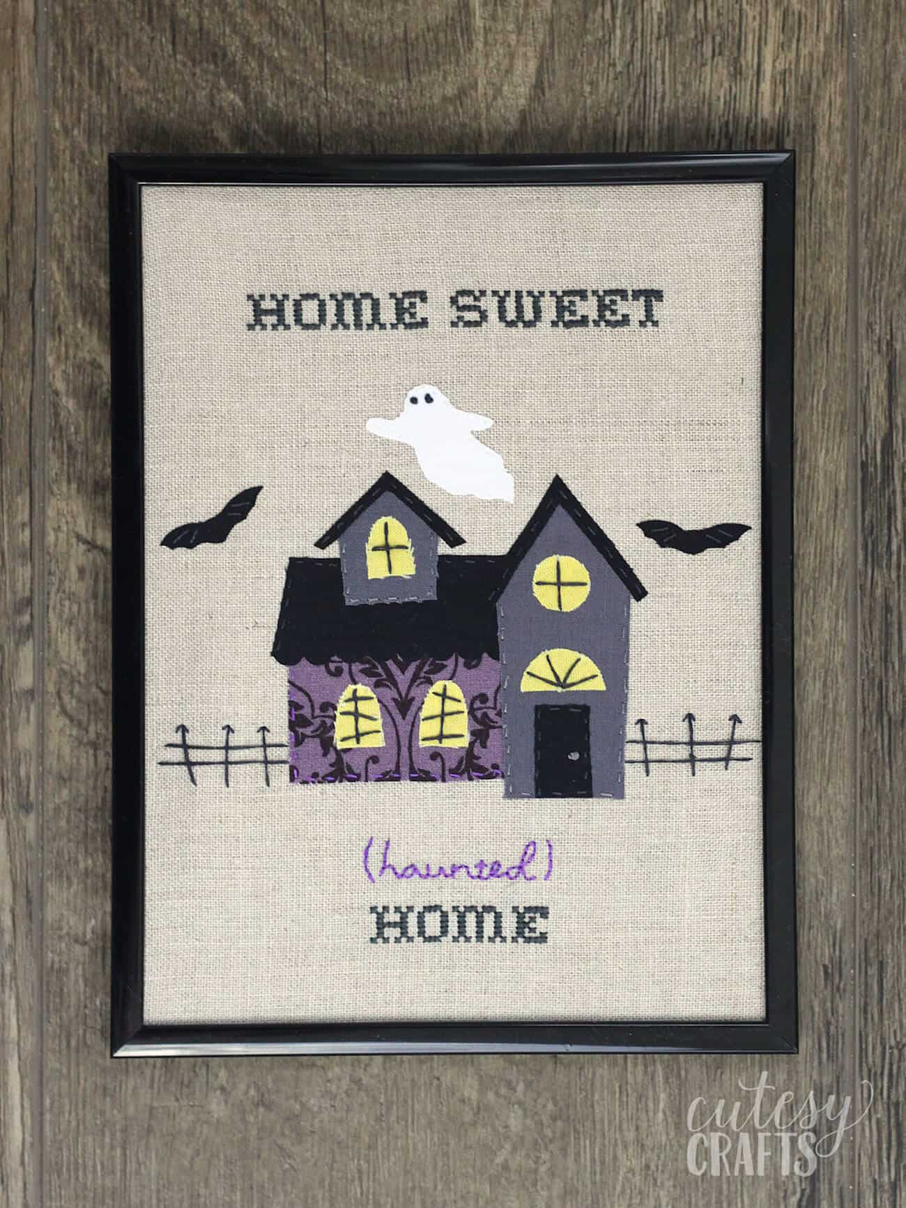 "Learn to make this cute ""Home Sweet (Haunted) Home"" Halloween embroidery wall hanging - and use up your fabric scraps. Get a free pattern too!"