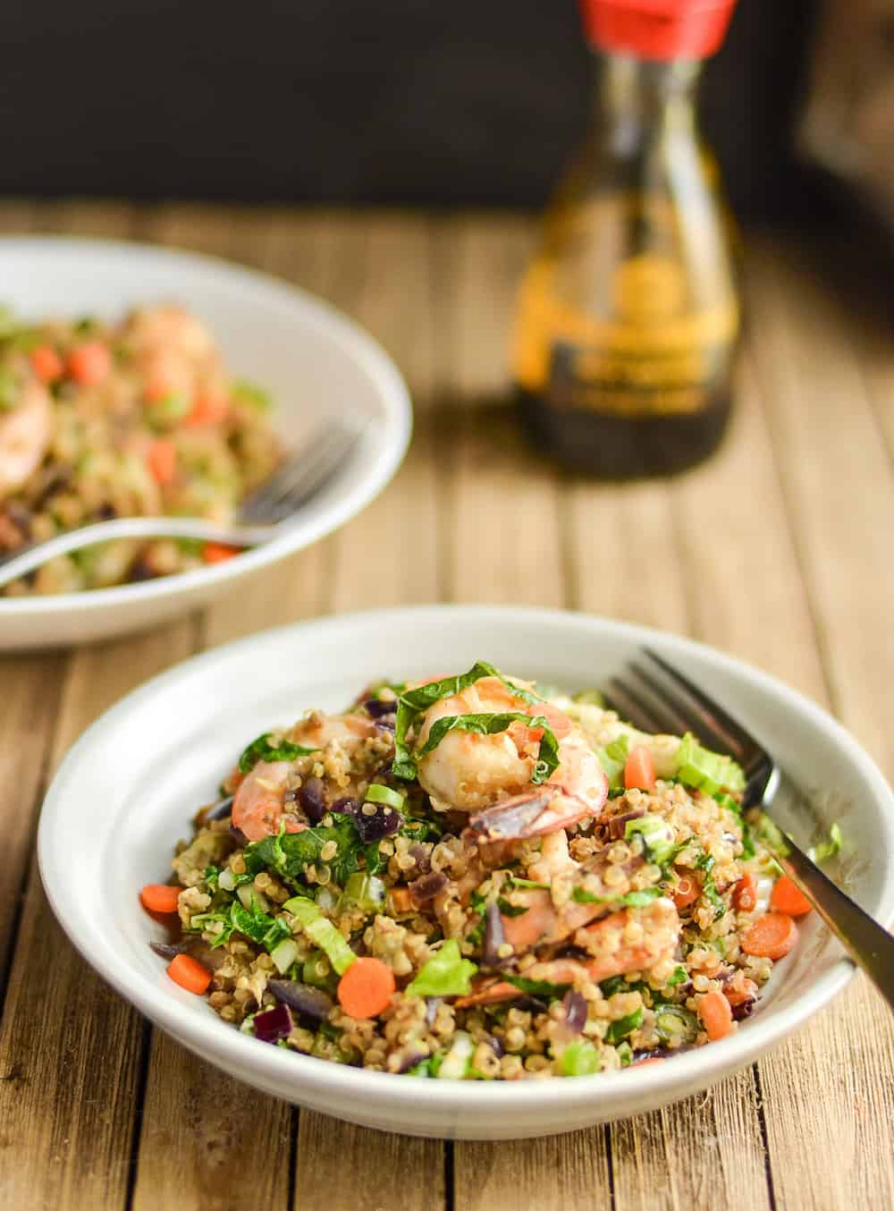 You'll love this delicious shrimp quinoa fried rice recipe! Full of crisp veggies, tasty shrimp, and with a subtle flavor of garlic and ginger. So yummy!