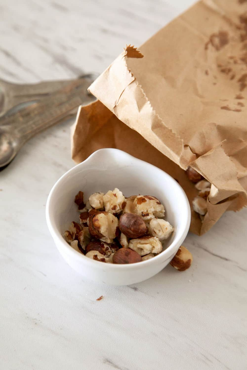 Hazelnuts out of a brown paper bag