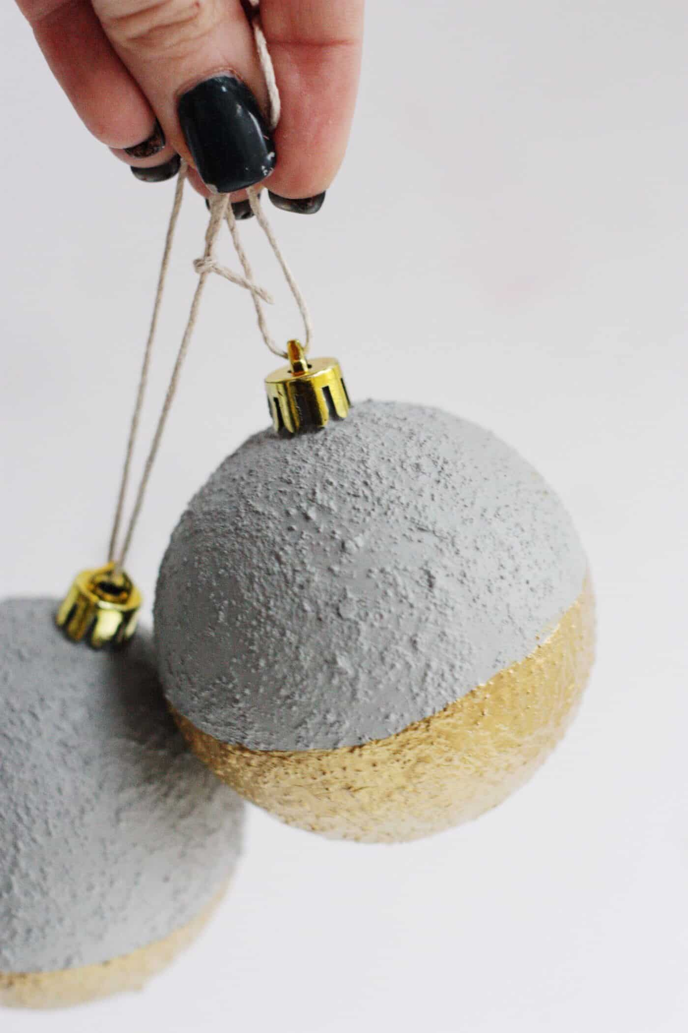 Create modern, unique concrete ornaments without the weight of actual cement! These are so easy to make and look great on your tree.