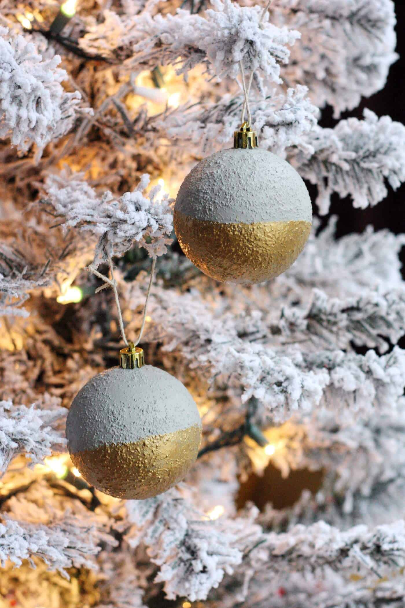 Modern concrete ornaments on a flocked Christmas tree