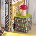Learn to make these DIY bookends using supplies found at the craft store! Isn't the gnome and mushroom theme so cute? Perfect for kids' rooms.
