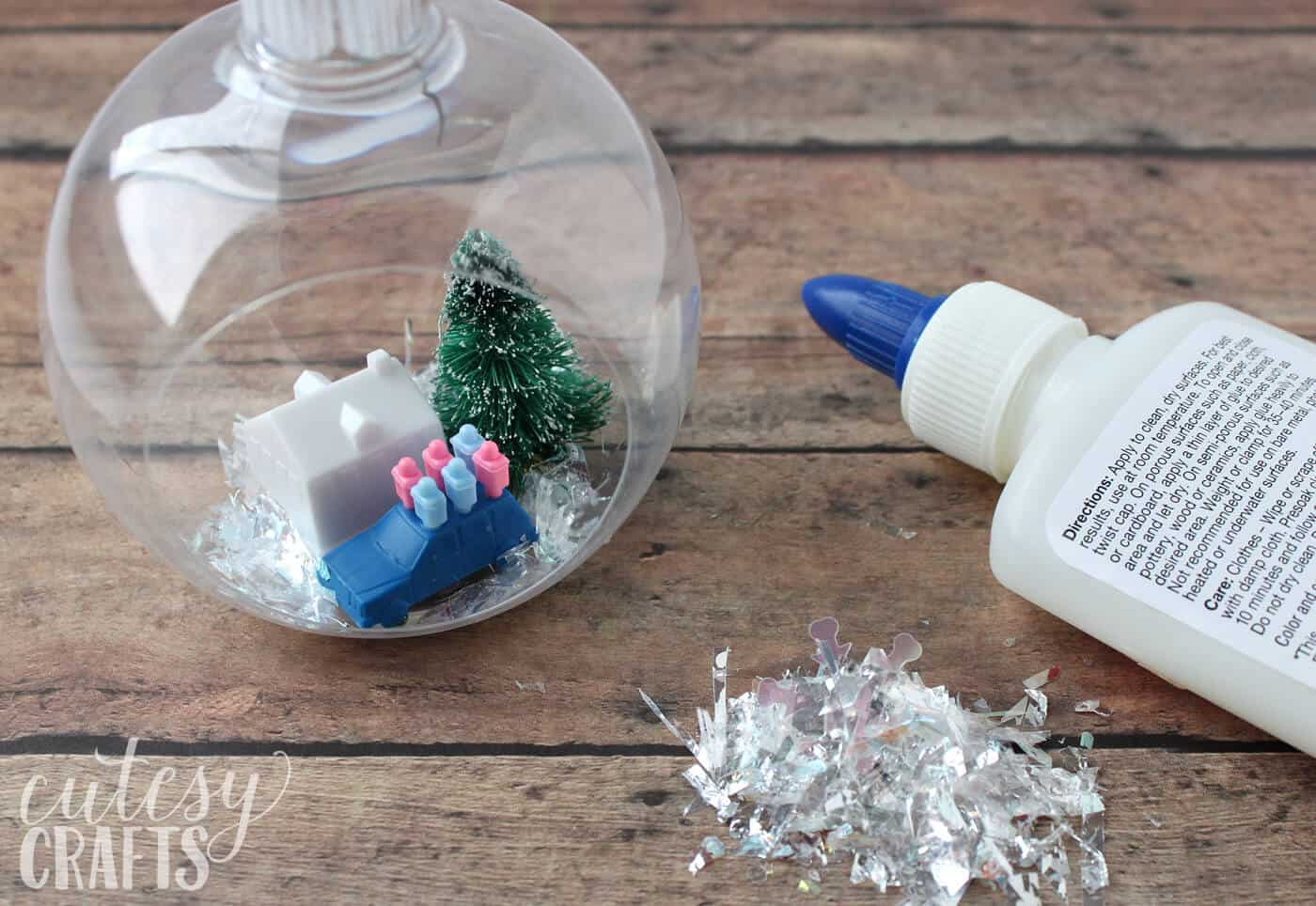 "Do you love making your own DIY Christmas tree ornaments? This fun ""Game of Life"" version is based on the popular game from your childhood!"