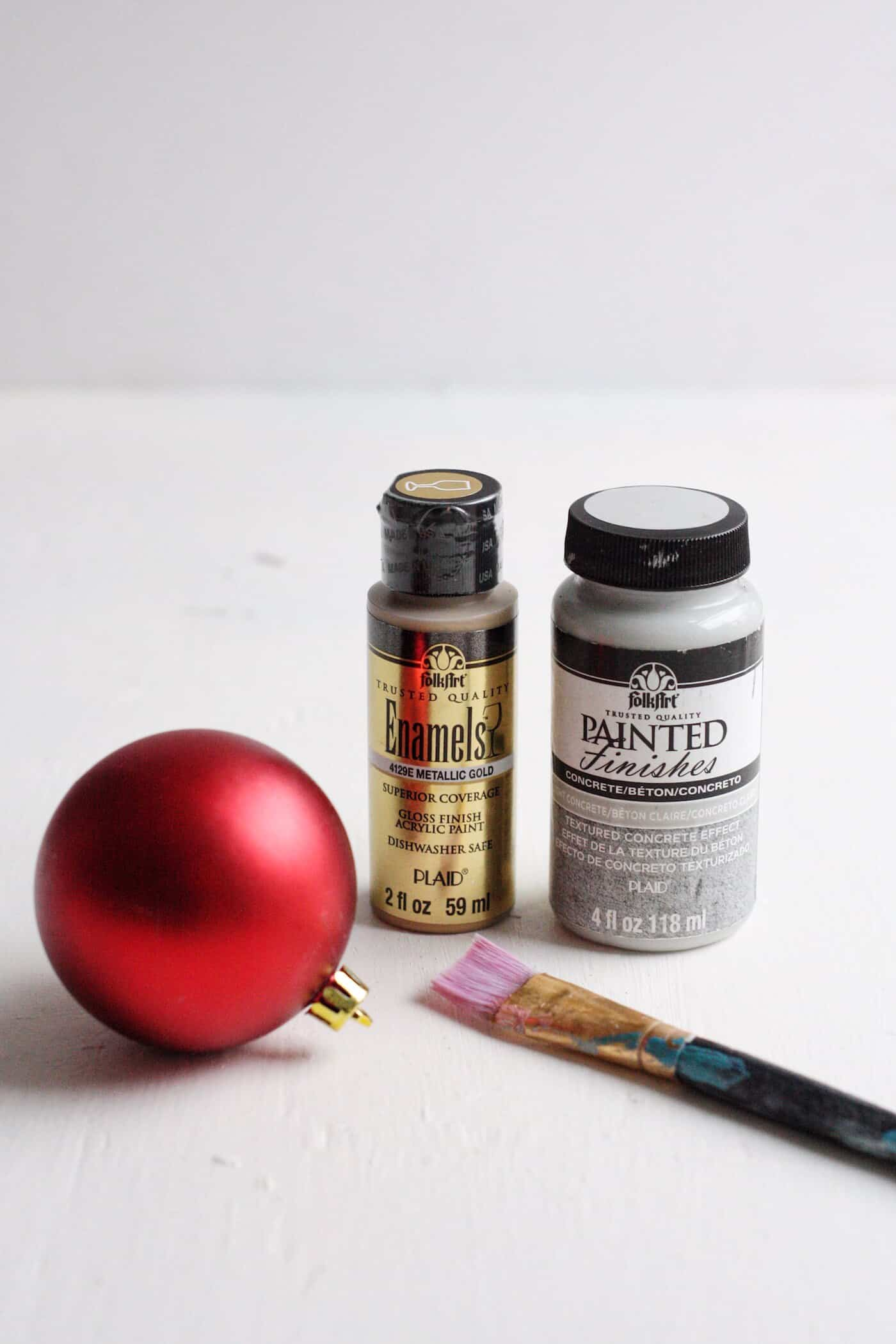 Red Christmas ball ornament, Enamel gold paint, and concrete painted finish with a paint brush
