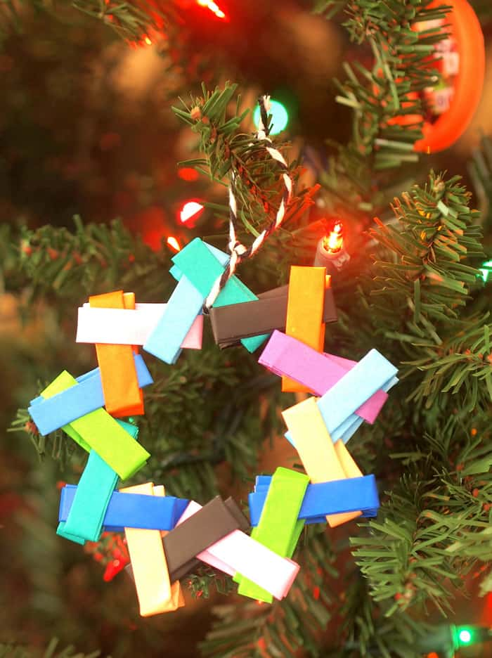 Make these colorful Christmas Tree ornaments using bright and cheery origami paper! These are so easy and teach kids folding skills.