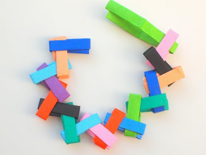 Make an origami paper chain and fold into a circle