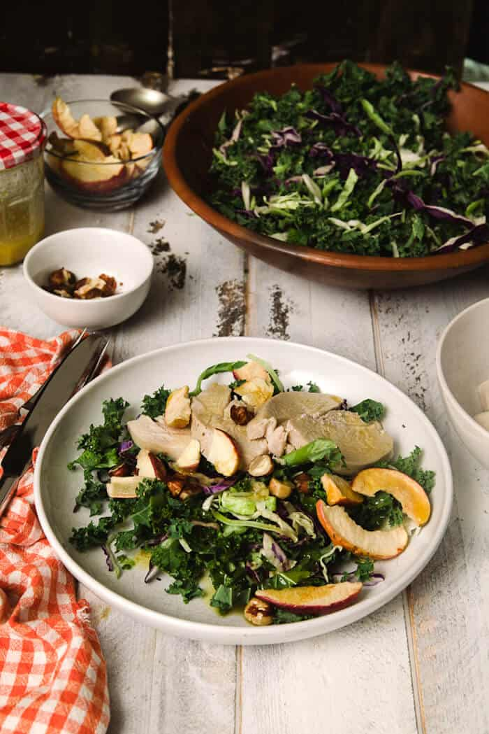 This kale salad recipe is healthy and oh-so-easy to prepare! The poached chicken is tender and the apple dressing is amazing.