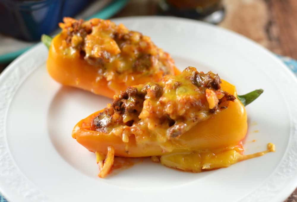 This delicious stuffed mini peppers recipe is VERY easy! Make for dinner or an appetizer - and use your choice of ground meats for filling.