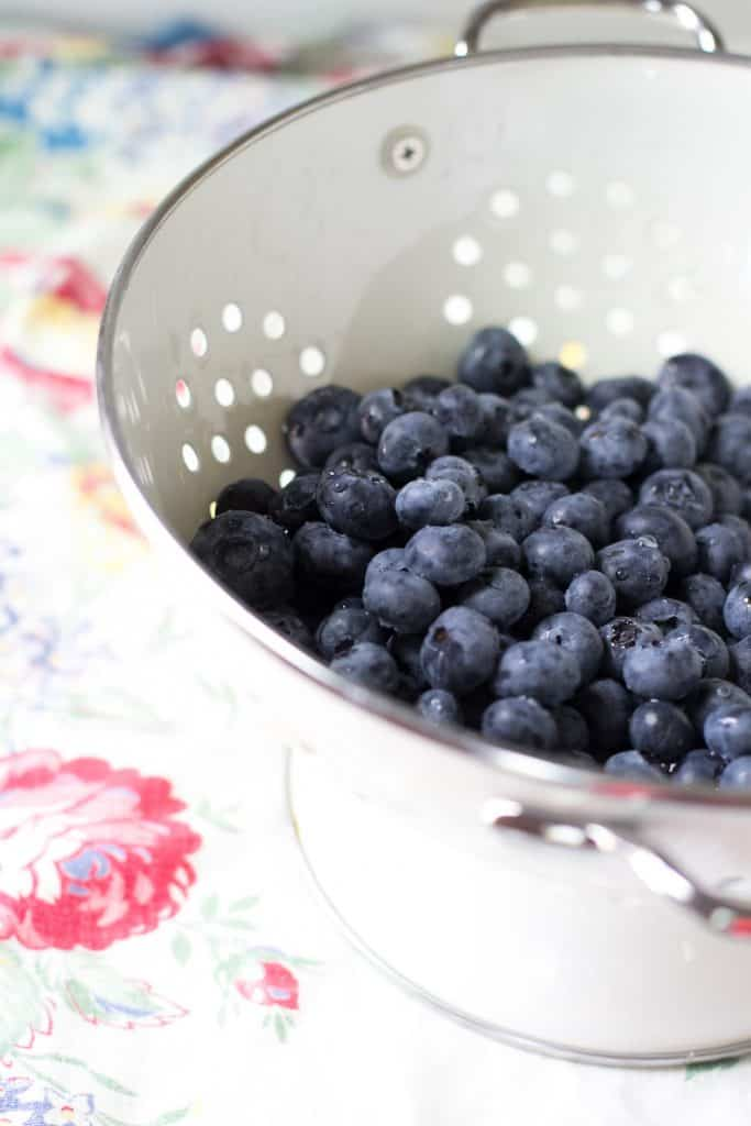 Blueberries in a white ceramic colander