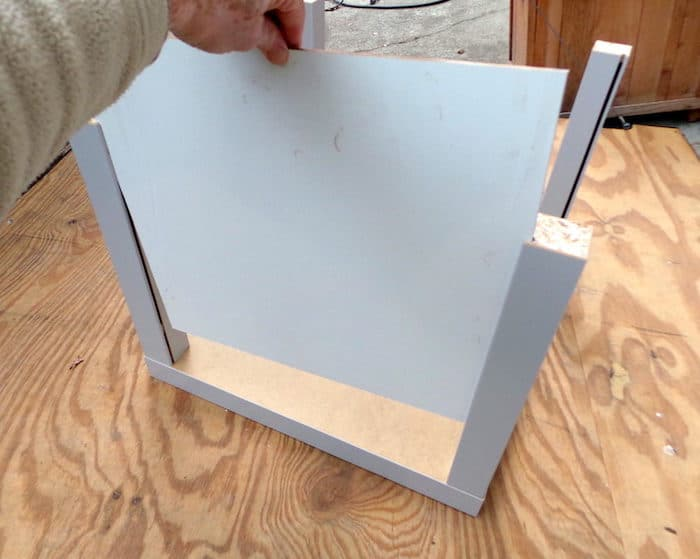 In this IKEA hack you'll make a DIY endtable out of square Lack tables! You'll love the modern design and the sliding doors on the front.